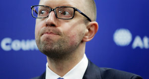 WASHINGTON, DC - MARCH 12: Ukraine Prime Minister Arseniy Yatsenyuk speaks at a news conference at the Atlantic Council on March 12, 2014 in Washington, DC. Yatsenyuk was in Washington to discuss the current situation of the Russian military intervention in the Crimea area.   T.J. Kirkpatrick/Getty Images/AFP
